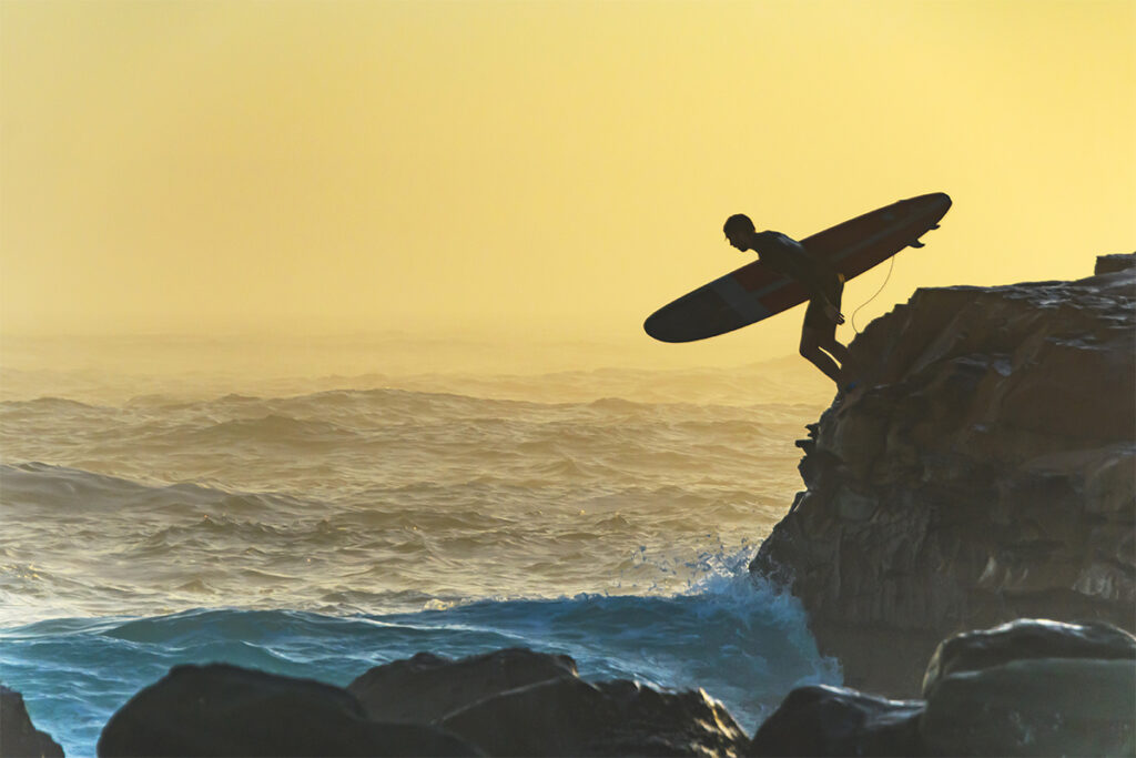 surfer jumping in waves